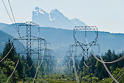Electrical powerlines advance towards the distant Baring Mountain. Wallace Falls State Park, Washington, USA.