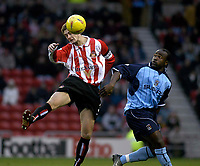 Photo. Glyn Thomas.<br /> Sunderland v Coventry City. Nationwide Division 1.<br /> Stadium of Light, Sunderland. 08/11/03.<br /> Sunderland's George McCartney (L) leaps high to prevent Patrick Suffo from gaining possession.