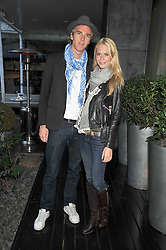 JAMES COOK and POPPY DELEVINGNE at the Total Concierge launch party held in the stylish Courtyard Garden at Sanderson, Berners Street, London on 26th May 2009.