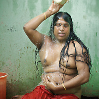 ..India's transexual community has a recorded history of more than four thousand years. Many consider the The Third Sex, also known as Aravanis, to posses special powers allowing them to determine the fate of others. As such, they are not only revered but despised and feared too. Resigned to the fringes of society, segregated and excluded from most occupations, many Aravanis are forced to turn to begging and sex work in order to earn a living. ..The annual transgender festival in the village of Koovagam, near Vilappuram, offers an escape from this often desolate existence. For some, the week-long partying and frenetic sex trade that culminates in the Koovagam festival is about fulfilling lustful desires. For others, the gathering provides a chance for transgenders to bond, share experiences, join the wider homosexual gay-community and coordinate their campaign for recognition and tackle the challenge of HIV/AIDS. ..It is the Indian state of Tamil Nadu that the eighty-thousand-strong Aravani community has made advances in their fight for rights. In 2009, the Tamil Nadu state government began providing sex-change surgery free of cost. The state has also offers special third-gender ration cards, passports and reserved seats in colleges. And 2008 the launch of Ippudikku Rose, a Tamil talk-show fronted by India's first transgender TV-host and the release of a mainstream Tamil film staring an Aravani in the lead-role. ..These advances clearly signal a victory for south India's transgenders, but they have also exposed deep divisions within the community. There is a very real gulf that separates the majority poor from their potentially influential but often reticent, upper-class sisters. ..Photo: Tom Pietrasik.Chennai, Tamil Nadu. India.May 2009