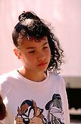 Girl age 11 at neighborhood celebration.  St Paul  Minnesota USA