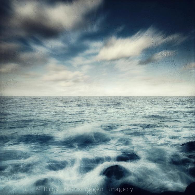View of the Atlantic Ocean from Puerto Naos-La Palma-Canary Island - waves washing over lava rocks - texturized photograph