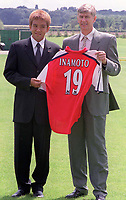 Fotball. Arsenal Manager Arsene Wenger with Arsenal's new signing Junichi Inamoto. Arsenal Training Ground, Sopwell House, 23.7.01. Credit: Colorsport / Andrew Cowie.