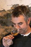 Christophe Bousquet Chateau Pech-Redon. La Clape. Languedoc. Owner winemaker. Tasting wine. France. Europe.