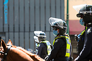 Mounted Brach members are seen during the Melbourne Freedom Rally at Parliament House. Police move into position on the steps of state parliament ahead of a planed protest. The groups who have organised the many Freedom Day protests over the last 3 months, attempted to march on State Parliament during Melbourne Cup Day demanding the sacking of Premier Daniel Andrews for the lockdown and attacks on their civil liberties. Police met with the protester's with significant force despite the city having had zero cases for five days. (Photo by Dave Hewison/Speed Media)