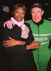MISS LAUREN BURGESS and MR ANDREW NEIL former editor of the Sunday Times, at a party in London on 10th November 1998.MLT 9