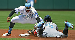 June 18, 2017 - Baltimore, MD, USA - Baltimore Orioles' Jonathan Schoop, top, tags out St. Louis Cardinals' Dexter Fowler during a steal attempt in the first inning on Sunday, June 18, 2017 at Oriole Park at Camden Yards in Baltimore, Md. The Orioles defeated the Cardinals, 8-5. (Credit Image: © Kenneth K. Lam/TNS via ZUMA Wire)