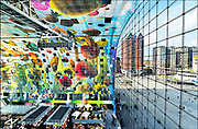 Nederland, the Netherlands, Rotterdam 23-6-2017In de overdekte markthal kun je veel verschillende culinaire producten kopen en eten. De exotische producten en retsaurants vormen een speeltuin voor de liefhebber van lekker eten.Kleurrijk interieur van de Markthal in Rotterdam, de eerste overdekte marktvloer van Nederland. De markthal is tot winnaar uitgeroepen tijdens de Dag van de Projectontwikkeling. Colorful interior of artistic market hall, winner of various international architecture awards 2015. The artwork on the ceiling, 11,000 m2, is by Arno Coenen. The building is designed by Winy Maas. The city Rotterdam was recently named by the New York Times and travel guide Rough Guide to a mustsee destination.  Architect firm MVRDVFOTO: FLIP FRANSSEN/ HH