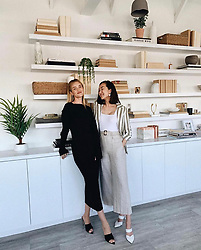 """Rosie Huntington-Whiteley releases a photo on Instagram with the following caption: """"Content creating with this babe @chrisellelim #comingsoon \ud83d\udda4"""". Photo Credit: Instagram *** No USA Distribution *** For Editorial Use Only *** Not to be Published in Books or Photo Books ***  Please note: Fees charged by the agency are for the agency's services only, and do not, nor are they intended to, convey to the user any ownership of Copyright or License in the material. The agency does not claim any ownership including but not limited to Copyright or License in the attached material. By publishing this material you expressly agree to indemnify and to hold the agency and its directors, shareholders and employees harmless from any loss, claims, damages, demands, expenses (including legal fees), or any causes of action or allegation against the agency arising out of or connected in any way with publication of the material."""