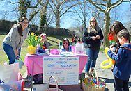 North Merrick, New York, USA. March 31, 2018. Sitting at table, LUCY MURPHY, a member of American Legion Auxiliary Post 1282 and (right of her) SUE MOLLER, co-Pres. of NCMCA, and others are at Entrance table to Eggstravaganza at Fraser Park.