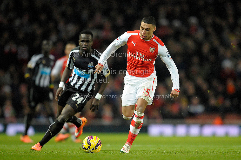 Alex Oxlade-Chamberlain of Arsenal in action. Barclays Premier league match, Arsenal v Newcastle Utd at the Emirates Stadium in London on Saturday 13th December 2014.<br /> pic by John Patrick Fletcher, Andrew Orchard sports photography.