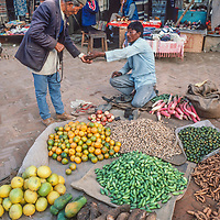 A man sells vegetables at a street bazaar in Kathmandu, Nepal, 1986.