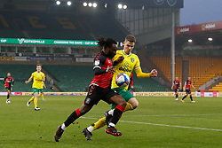 Jacob Lungi Sorensen of Norwich City & Fankaty Dabo of Coventry City battles for possession- Mandatory by-line: Phil Chaplin/JMP - 28/11/2020 - FOOTBALL - Carrow Road - Norwich, England - Norwich City v Coventry City - Sky Bet Championship