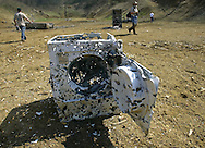 Whats left of a washing machine used as a target during the Knob Creek Machine Gun Shoot near West Point, Kentucky April 10, 2005. Thousands of machine gun and military hardware enthusiasts attended the event held each year over weekends in the spring and fall.