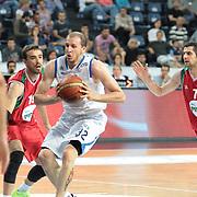 Anadolu Efes's Sinan Guler (C) during their Turkish Basketball League Play Off match Anadolu Efes between Pinar Karsiyakaat Sinan Erdem Arena in Istanbul, Turkey, Sunday, May 06, 2012. Photo by TURKPIX
