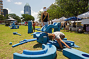 A child plays with oversize blocks at the Farmer's Market in downtown Austin, Texas.