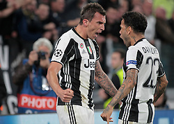 Mario Mandzukic and Dani Alves and during Champions League Semi-finals match between Juventus v Monaco, in Turin, on may 9, 2017.(Photo by Loris Roselli/NurPhoto) *** Please Use Credit from Credit Field ***