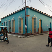 Bicycle taxi at intersection in Trinidad, Cuba