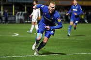 AFC Wimbledon midfielder Mitchell (Mitch) Pinnock (11) celebrating after scoring goal to make it 1-1 during the EFL Sky Bet League 1 match between AFC Wimbledon and Burton Albion at the Cherry Red Records Stadium, Kingston, England on 28 January 2020.