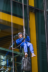 London, September 7th 2015. PICTURED: Bill Roberts of Clogau Goldmine abseils down the side of 20 Fenchurch Street. The Outward Bound Trust City Three Peaks Challenge in conjunction with The Royal Navy and Royal Marines Charity is a breathtaking abseiling endeavour on the greatest urban mountain range: The City of London.