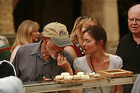"""The Saturday market in Uzès, Languedoc, France..Trying """"pelardon"""" goat cheese..October 6, 2007..Photo by Owen Franken for the NY Times...Assignment ID: 30049869AThe Saturday market in Uzes, Languedoc, France..""""Pelardon,"""" small goat cheeses..October 6, 2007..Photo by Owen Franken for the NY Times...Assignment ID: 30049869A"""