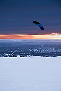 Paraglider prepares for takeoff in Lapland, Finland.