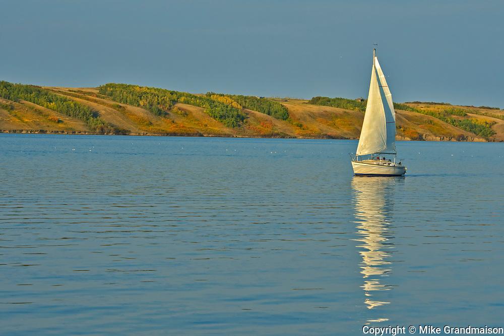 Sailboat in Lake Manitou, a saltwater lake on the Canadian priaires<br />Lake Manitou<br />Saskatchewan<br />Canada