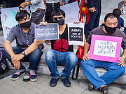 20 MAY 2014 - BANGKOK, THAILAND:  Thais with signs protesting the army declaration of martial law. About 200 Thais gathered at the Bangkok Art and Culture Centre in central Bangkok to protest the army's decision to impose martial law.    PHOTO BY JACK KURTZ