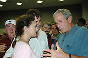 President Bush speaks with the mayor of Gulfport Brent Warr and his wife Laura  after his remarks at the Pearl River Community College in Poplarville Ms. Monday Sept. 5,2005.He told the Mayor of Gulfport one of the hardest hit areas from the storm that he has Mississippi on his mind and will do whatever is necessary to fix and clean up the destruction. Hurricane Katrina is the worst natural disaster to hit American soil and the National and local goverments are working together to clean up the mess from the catasrophic destruction. (Photo/Suzi Altman)