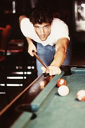 good looking man shooting pool in New York City