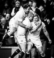 Picture by Andrew Tobin/SLIK images +44 7710 761829. 2nd December 2012. Chris Ashton of England celebrates with Mike Brown (C) and Brad Barritt (L) after scoring his try during the QBE Internationals match between England and the New Zealand All Blacks at Twickenham Stadium, London, England. England won the game 38-21.