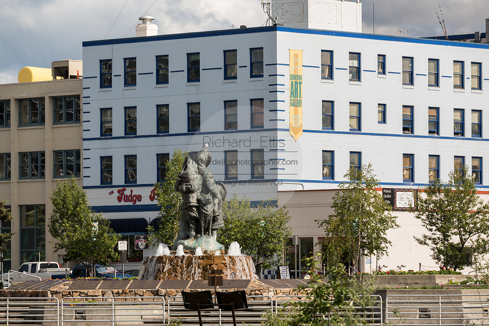 Golden Heart Plaza and the statue by artist Malcolm Alexander called the Unknown First Family, downtown  in Fairbanks, Alaska. The downtown plaza was built to celebrate the silver anniversary of Alaska statehood in 1984.