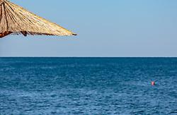 THEMENBILD - ein Sonnenschirm aus Strohdach auf einem einsame Strand, aufgenommen am 26. Juni 2018 in Porec, Kroatien // a parasol made of straw roof on a lonely beach, Porec, Croatia on 2018/06/26. EXPA Pictures © 2018, PhotoCredit: EXPA/ Stefanie Oberhauser