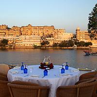 Asia, India, Udaipur. Table setting on rooftop restaurant Bhairo at Taj Lake Palace Hotel.