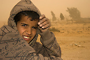 Israel, Negev Desert, Bedouin boy during a desert sand storm