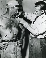 1951 Humphrey Bogart & make-up artist at United Artist Studio