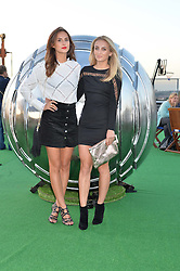 Left to right, LUCY WATSON and TIFFANY WATSON at the launch of the Orangina Boulers Rooftop Petanque held on the top floor of the Stratford Multistorey Car Park, Great Eastern Way, London E15 on 26th August 2015.