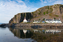 Row of whitewashed houses in harbour at Ellenabeich village at Easdale on Seil Island, one of the slate islands, Argyll and Bute, Scotland, UK