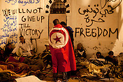Tunis, Tunisia. January 26th 2011.Protesters are about to spend their third night (in defiance of a curfew) in front of the Prime Minister's office (Mohammed Ghannouchi) on the Kasbah Square. They demand the removal of Mohammed Ghannouchi and members of the ousted president's regime (Zine El Abidine Ben Ali) still in the the government. ....