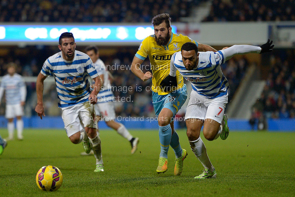 Matt Phillips of QPR and Joe Ledley of Crystal Palace (c) chasing the ball. Barclays Premier league match, Queens Park Rangers v Crystal Palace at Loftus Road in London on Sunday 28th December 2014.<br /> pic by John Patrick Fletcher, Andrew Orchard sports photography.