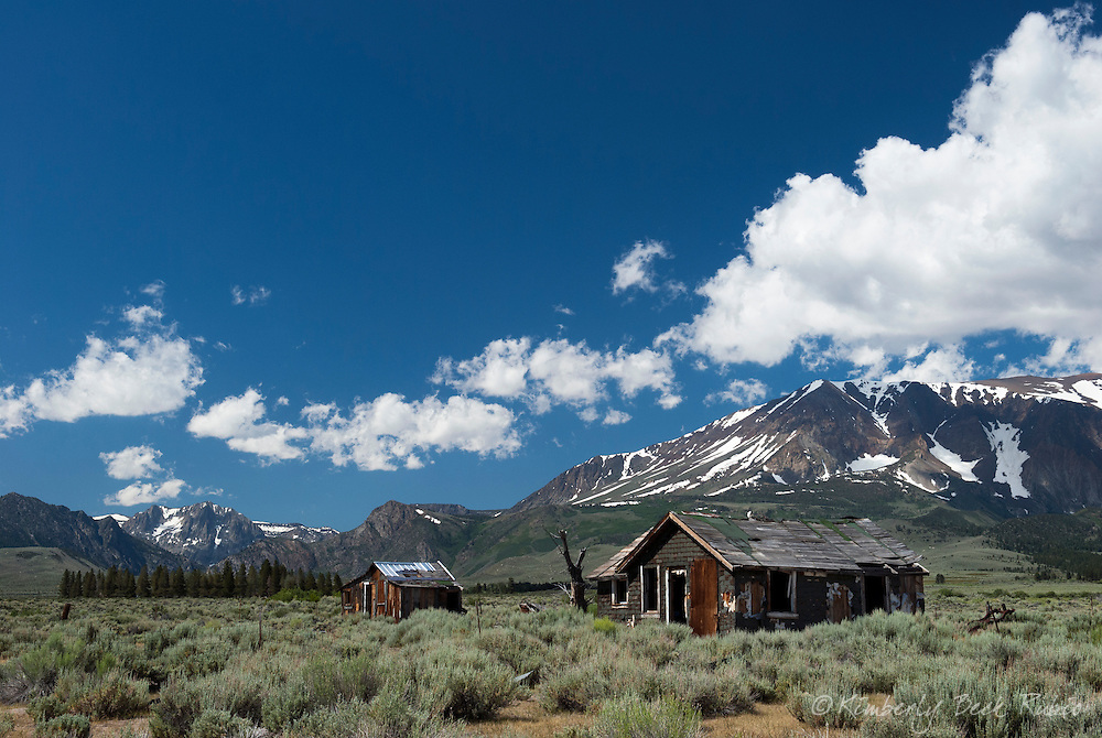 Abandoned cabins surrounded by sagebrush in front of the Eastern Sierra, in the Owens Valley, California.