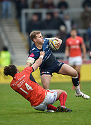 Sale Sharks wing Will Addison is held by  Saracens wing Mike Ellery during the Aviva Premiership match Sale Sharks -V- Saracens at The AJ Bell Stadium, Salford, Greater Manchester, England on November  20  2016. (Steve Flynn/IOS via AP)
