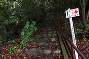 A sign showing the way to the next temple for pilgrims, on the Shikoku 88 temple pilgrimage, known as henroo, at  Ishite temple, Matsuyama, Eihime, Japan.. Friday, June 26th 2015