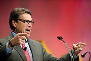 Texas Gov. Rick Perry speaks during the Defending the American Dream Summit hosted by Americans For Prosperity at the Omni Hotel in Dallas, Texas on August 29, 2014. (Cooper Neill for The New York Times)