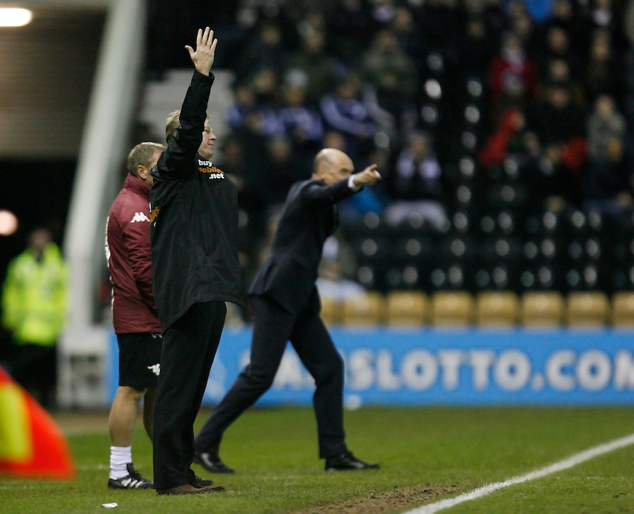 Derby County's Manager Steve McClaren (L) and Wigan Athletic's Manager Uwe Rosler<br /> <br /> Photo by Jack Phillips/CameraSport<br /> <br /> Football - The Football League Sky Bet Championship - Derby County v Wigan Athletic - Wednesday 1st January 2014 - The iPro Stadium - Pride Park - Derby <br /> <br /> <br /> <br /> © CameraSport - 43 Linden Ave. Countesthorpe. Leicester. England. LE8 5PG - Tel: +44 (0) 116 277 4147 - admin@camerasport.com - www.camerasport.com