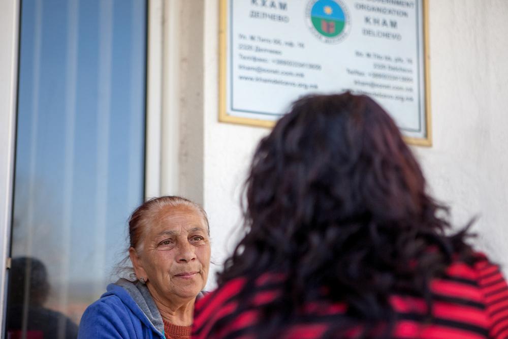 NGO Kham client Sazije Fazlievik talking to paralegal Sanela Abdulova at the office of the organisation in the city of Delcevo, Macedonia.