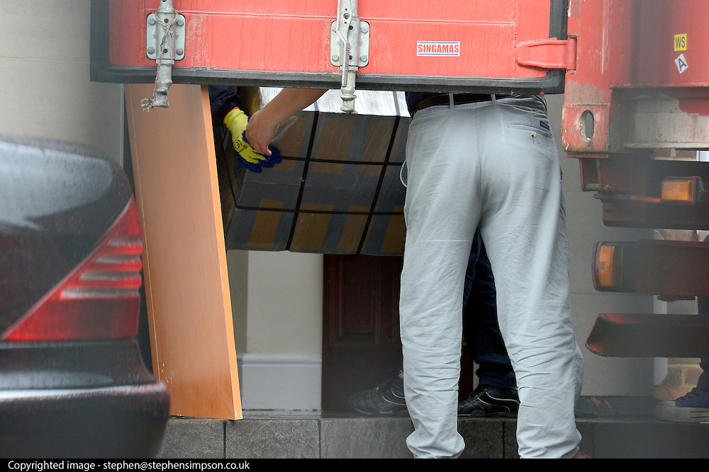 © Licensed to London News Pictures. 09/04/2013. London, UK The container is reversed into the door to prevent media seeing activity. Boxes are loaded into a shipping container from the North Korean Embassy in Ealing London today 9th April 2013. On Friday North Korea warned it would not be able to guarantee the safety of embassy staff in their country in the event of a war. Photo credit : Stephen Simpson/LNP