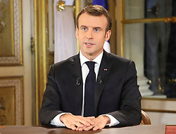 French President Emmanuel Macron speaks during a special address to the nation, his first public comments after four weeks of nationwide 'yellow vest' (gilet jaune) protests, on December 10, 2018, at the Elysee Palace, in Paris. Photo by Ludovic Marin / Pool/ABACAPRESS.COM