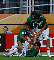 Photo: Glyn Thomas.<br />Mexico v Iran. Group D, FIFA World Cup 2006. 11/06/2006.<br /> Mexico's Zinho (bottom) is mobbed by teammates after scoring his side's third goal.