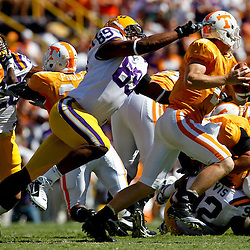Oct 2, 2010; Baton Rouge, LA, USA; Tennessee Volunteers quarterback Matt Simms (2) is pursued by LSU Tigers defensive end Lavar Edwards (89) at Tiger Stadium.  Mandatory Credit: Derick E. Hingle